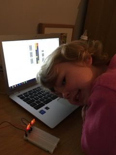 Sienna wiring up LED's on a breadboard